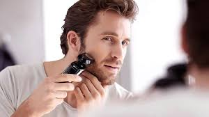 how to use the electric shaver
